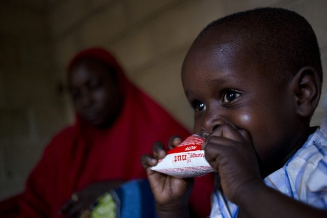 Internally displaced Alagi Dubji  son Oumar (3 and a half) eat a peanut butter supplement, at their home in Maroua in Northern Cameroon, Monday 4 April 2016. Oumar walked for 5 kilometres to look for help when their house was attacked . Alagi and his family had to flee from his village near Maroua after Boko Haram fighters burned down his house.Alagi had 40 children with 26 still alive.The conflict in North-East Nigeria prompted by Boko Haram has led to widespread displacement, violations of international humanitarian and human rights law, protection risks and a severe humanitarian crisis. This is one of the fastest growing displacement crisis in Africa – one of the world's most forgotten emergencies, with little attention from the donor community. Across Nigeria, Niger, Cameroon and Chad, over 2.7 million people – mostly women and children – have now fled the Boko Haram-related violence. Many children have been subject to grave violations including forced recruitment, and being used as suicide bombers. Women and girls have been trafficked, raped, abducted and forcibly married. Schools have been attacked, looted, damaged or used as shelter by displaced families. The conflict is exacting a heavy toll on children, affecting not just their well-being and their safety but also their access to basic health, education, nutrition and social services.