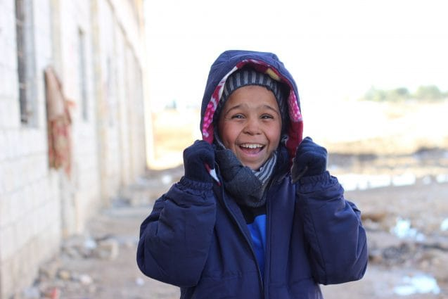 On 12 December 2016, Ahmed gives a radiant smile as he finds out that the clothes he was given were exactly his size. Over 5,000 children recently displaced from eastern Aleppo city have received winter clothes provided by UNICEF. Displaced children like Ahmed are especially vulnerable at this time of year. As temperatures drop, children are at risk of hypothermia, pneumonia and other deadly diseases. With both parents dead and no other relatives to look after him or his four siblings, Ahmed came to the shelter from East Aleppo with neighbors. Winter is the latest threat to children in conflict-ridden Aleppo. As people continue to flee the besieged Syrian city of Aleppo, UNICEF is working to reach displaced families with the supplies they need to survive the brutal winter. Some children have lost or become separated from their families, leaving them even more vulnerable. Five days ago, 10-year-old Ahmed arrived in Jibreen, an industrial district on the outskirts of Aleppo. Ahmed's parents were killed in the vicious conflict engulfing the city. He and his four siblings have nobody to take care of them and help keep them warm. The journey to Jibreen was gruelling for five-year-old Rahaf, her two-year-old brother Wael, and their mother, who fled their home in east Aleppo. Their mother, a widow who suffered a shrapnel wound on her leg, had to wheel her children for hours until they could be transported by bus to the Jibreen shelter.